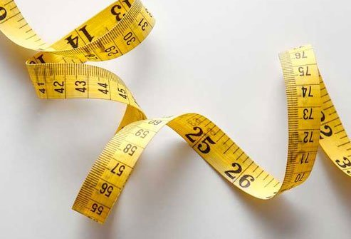 Breathe out, and wrap a tape measure around yourself midway between your hip bone and ribs.