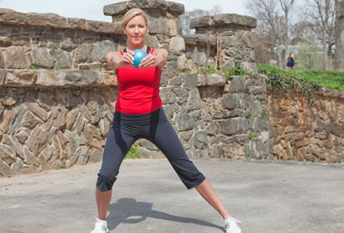 Photo of side lunge with front reach.