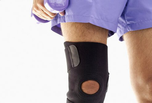 A person wears a knee brace for arthritis.