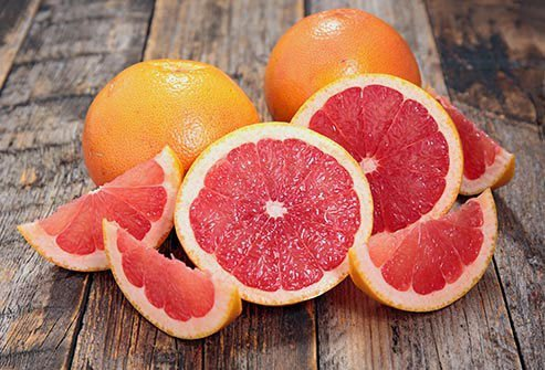 Sections and halves of grapefruit