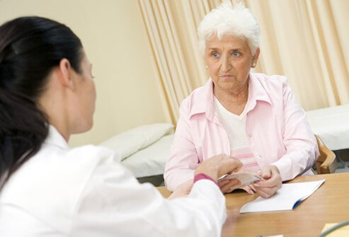 A doctor discusses osteoporosis treatment options with a patient.