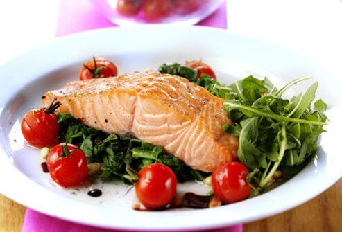 Photo of salmon and salad dish.