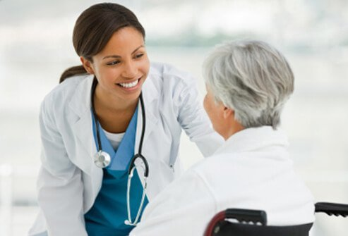 A doctor meets with a patient for follow-up care.