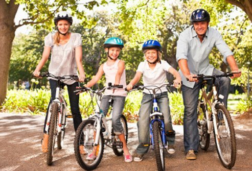 A family prepares for their bike ride.