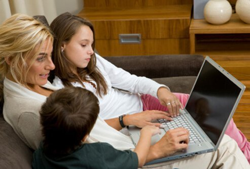 A mother shops with her children online.