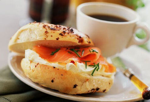 Photo of bagel with lox and coffee.