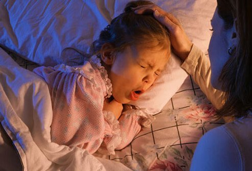 A girl in bed with whooping cough (pertussis).