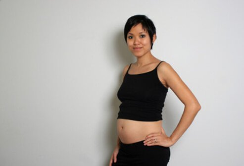 A pregnant woman starting to show.