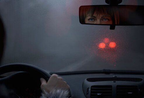 Photo of woman driving at night.