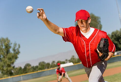 A baseball pitcher throwing the ball.
