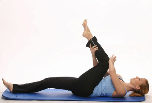 Photo of woman stretching her legs and lower back.