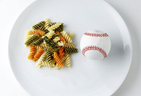 One half-cup of pasta is about the size of half a baseball.