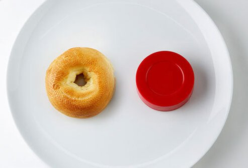 Photo of bagel and hockey puck.