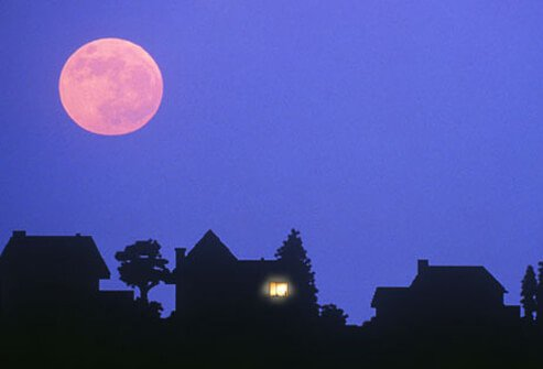 A silhouette of houses at night.