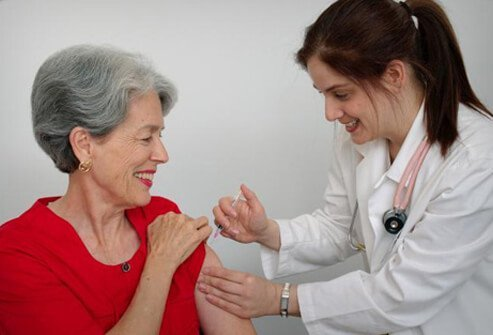 A woman receives the shingles vaccine.