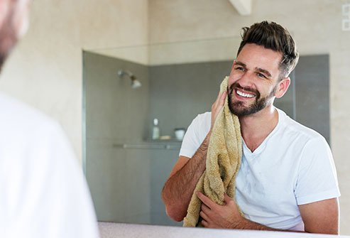 The right way to dry your face to avoid irritation is by patting.