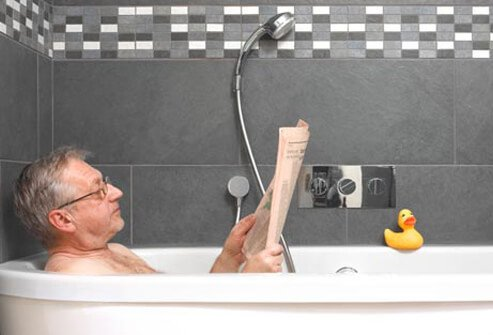 Photo of an older man taking bath.