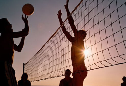 Photo of people playing volleyball.