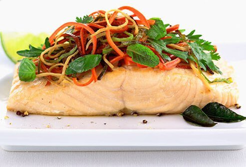 Salmon topped with leafy greens.