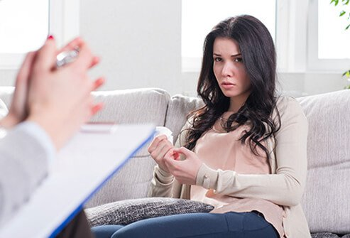 A counselor discusses drug addiction with a teenage girl.