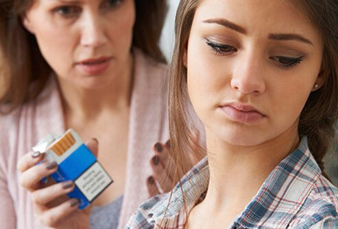 A mother confronts her teenage daughter over cigarettes she found.
