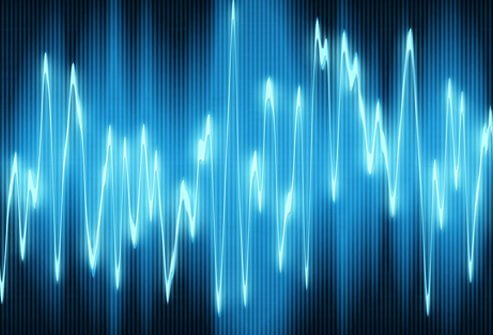 A sound wave oscillates on a black background.