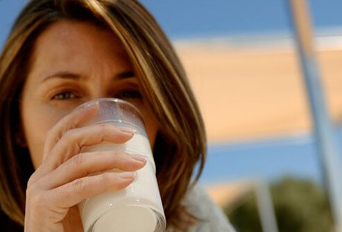 Photo of a woman drinking milk.