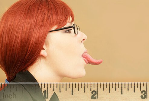 A woman shows off the length of her tongue.