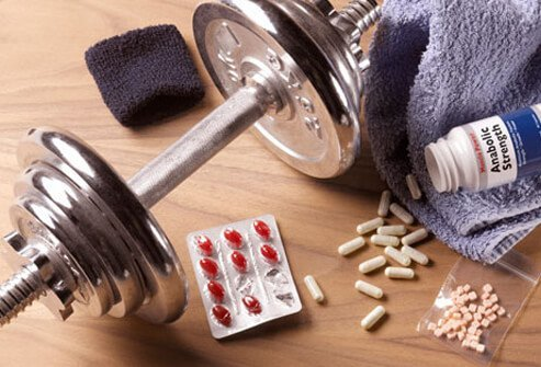 Photo of anabolic steroids, pills, and weights.