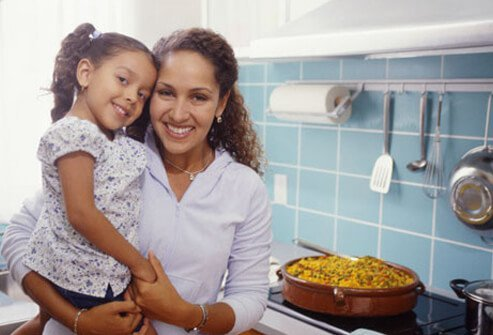 Mother and daughter in kitchen.