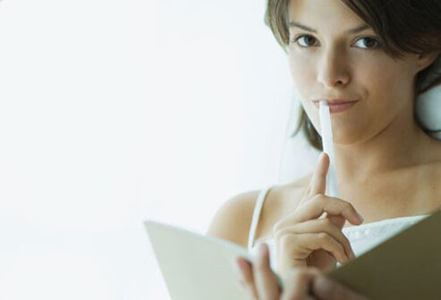 Woman with pen and diary.