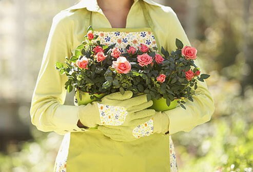 Photo of woman holding flowers, managing her lupus.