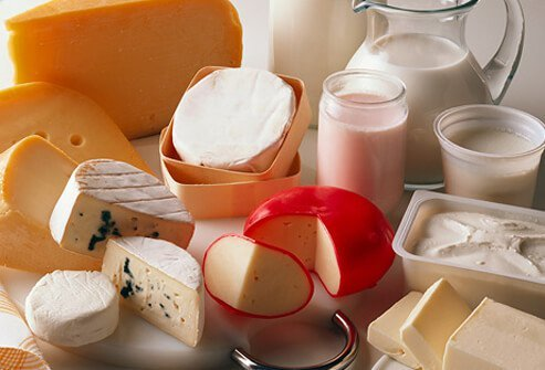 A photo of different types of cheese, milk, and tofu.