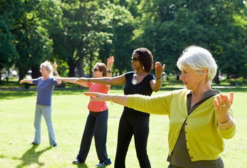 Women practicing tai chi in the park.