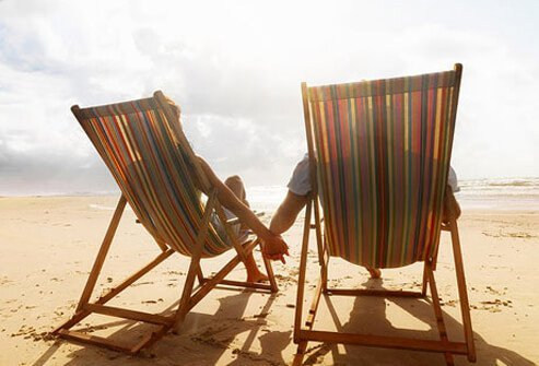 A couple relaxing on the beach.