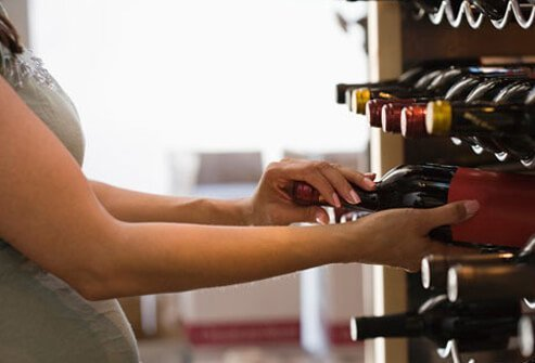 Photo of woman buying wine.