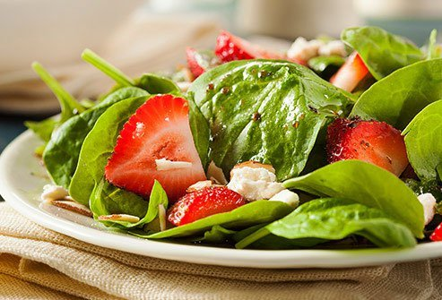 Strawberries are a lower-sugar fruit that make a colorful addition to salads.