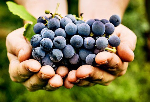 Grapes rank on the higher end of the fruit sugar content chart with 23 grams of sugar in one cup.