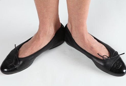Photo of woman wearing ballet flats.